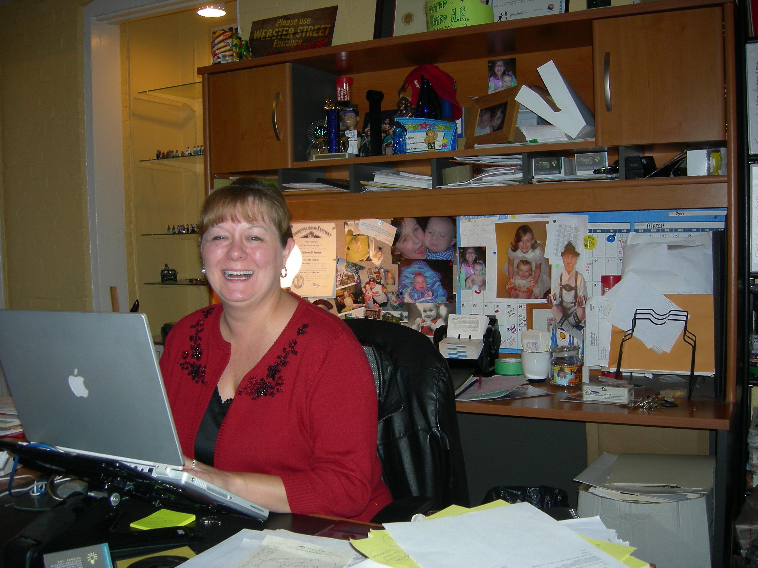 Kati at her desk