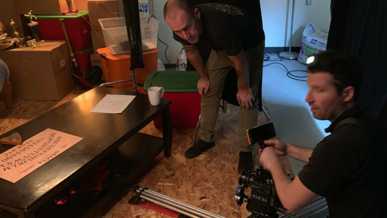 """C360 video production team members setting up a shot. This photo was used in a blog Current360 created entitled """"What's the point of advertising?"""" that highlighted importance of creativity in advertising and branding."""