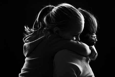 Young girl hugging a woman tightly around the neck. This was part of an awareness campaign for YMCA Safe Places Services, which provides shelter and support for at risk youth and families. This integrated campaign used bus shelter advertising, social media, and a SEM campaign that was geographically and age targeted to narrow our focus.